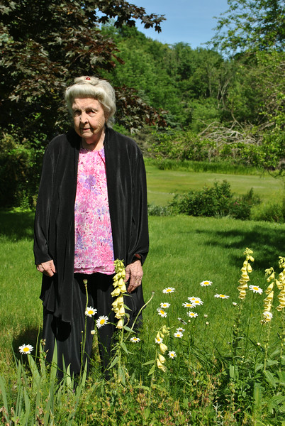 "Liljan Minck stands surrounded by yellow fox glove and daisies, at the edge of one of the gardens she has tended for over half a century.  (Crevier photo)<br /> <br /> PLEASE NOTE: Additional photos of Mrs Minck's garden are also available in a separate gallery:<br /> <a href=""http://photos.newtownbee.com/Journalism/Glimpse-of-the-Garden-Liljan/"">http://photos.newtownbee.com/Journalism/Glimpse-of-the-Garden-Liljan/</a>"
