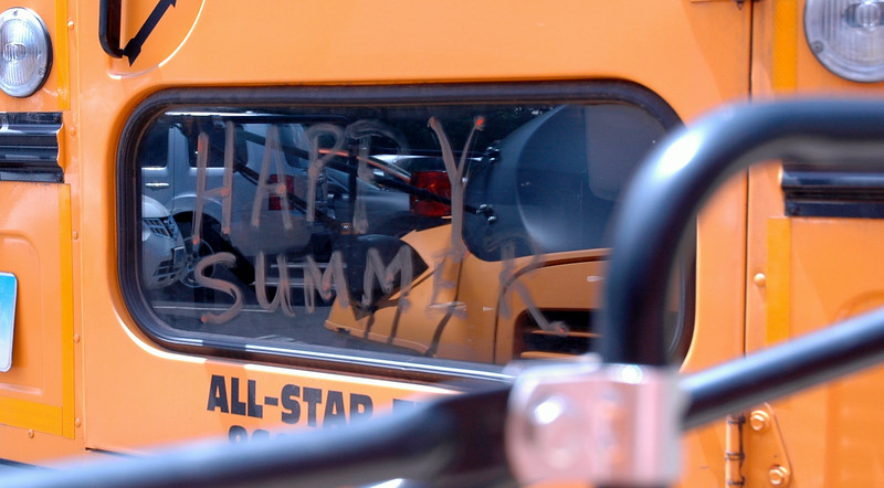 "A bus at Newtown Middle School had the words ""Happy Summer"" written on a window.  (Hallabeck photo)"