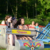 A trio of girls, hair flying behind them, all laugh as they ride The Scrambler.  (Bobowick photo)