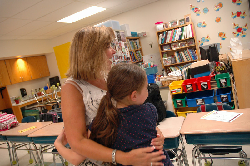 Retiring Hawley Elementary School Principal Jo-Ann Peters-Edmondson received a hug from a student minutes before students were dismissed for the summer.  (Hallabeck photo)