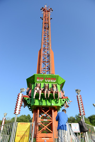 Courtney Cohane, Ashley Marron and Gianna Terracino have passed the point of no return as the ride they are on ascends, only to drop them back toward the ground moments later.  (Bobowick photo)