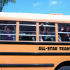 Hawley Elementary School students waved good-bye from on board their bus on June 18.    (Hallabeck photo)