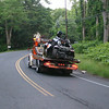 Two wreckers were called in to get an Audi Q-5 out of the woods along Berkshire Road after it went down an embankment and struck several trees around 11:45 pm June 21. A hook and flatbed from Hilario's were used to retrieve the vehicle, which was barely recognizable once its was on the flatbed early Sunday morning.  (Hicks photo)
