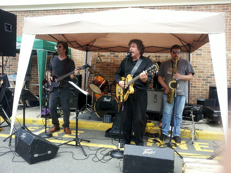 """A June 14 car show and raffle held outside Stop & Shop in Sand Hill Plaza featured a DJ, the Big Beat Band (above), food, activities for the kids, and dozens of hot rods, classics, customized, and stock vehicles ranging from vintage to a gull wing DeLorean complete with its space age """"flux capacitor."""" The event raised $10,000 in food and cash donations for FAITH Food Pantry.  (Voket photo)"""