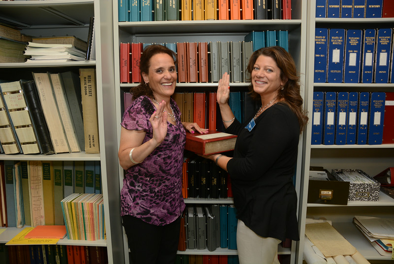 Town Tax Assessor Penny Mudgett, left, takes the oath of office on June 18 from Town Clerk Debbie Aurelia Halstead in the public records vault at the town clerk's office at Newtown Municipal Center. On June 16, the Board of Selectmen appointed Ms Mudgett as tax assessor. She had been serving as the town's interim tax assessor since the departure of former tax assessor Chris Kelsey, who took a similar position in Middlebury. Ms Mudgett has worked for the town for the past 14 years.  (Gorosko photo)