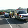 Sandy Hook Fire & Rescue and Newtown Volunteer Ambulance Corps responded around 7:20 am on Friday, June 20, to I-84 West, just west of the Rochambeau Bridge, after a Toyota Prius struck a deer that had run in front of the vehicle. The female driver of the Prius was checked by NVAC members and firefighters, but did not need to be transported to the hospital. The accident caused slight travel delays during the morning rush hour, but its affect was limited because the driver was able to pull her vehicle inside the construction area currently occupying part of the bridge and the slow speed lane immediately off the bridge. Firefighters checked the roadway for fluids, and returned to service around 8 am. The deer did not survive the impact.  (Hicks photo)