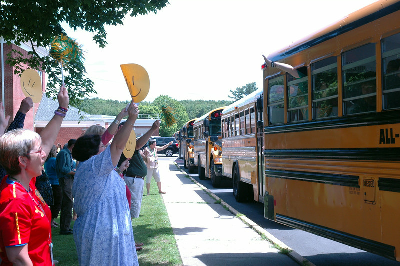 Newtown Middle School staff members waved goodbye to students as buses pulled out for the final time of the 2013-14 academic year.  (Hallabeck photo)