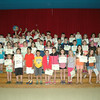 Head O' Meadow students who participated in the school's geography program stood together after the school's award assembly on Tuesday, June 17, for a photo. Standing with them are Kristen Mattera, top left, lead teacher Natalie Hammond, and Principal Barbara Gasparine, top right.  (Hallabeck photo)