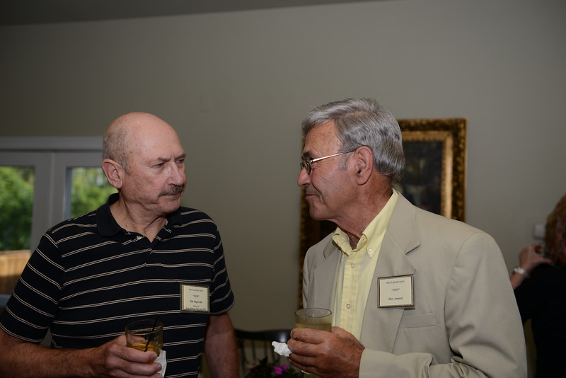 Sipping drinks and sharing conversation during a Newtown High School multi-class reunion at The Inn at Newtown Saturday, June 21, were Jim Paproski ('59) and Dan Amaral ('59).   (Bobowick photo)