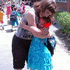 Retiring Hawley Elementary School art teacher Vicki Sheskin received a hug from Emma McIntosh at the end of the last day of school, right before Emma boarded her bus.  (Hallabeck photo)