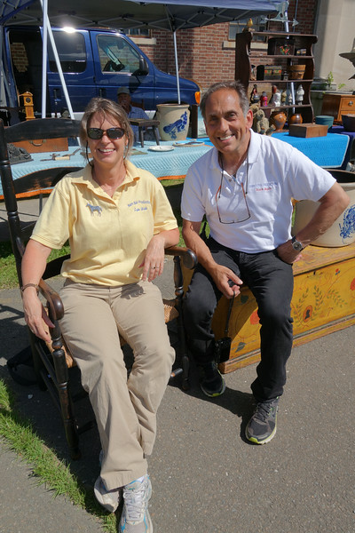 Frank Gaglio, antiques show manager, and his assistant, Lynn Webb, staged the first New-town Antiques Market on June 21 at Fairfield Hills.    (R.S. Smith photo)