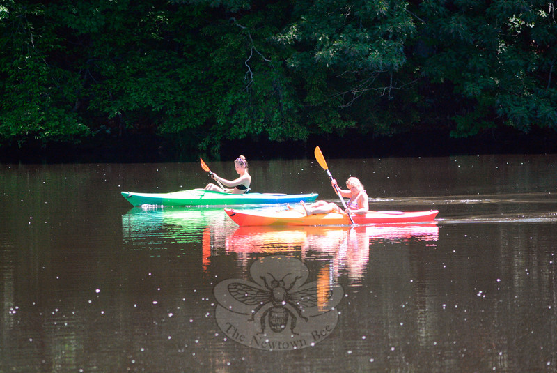 Enjoying brilliant sunshine and the heat of the day on Friday, May 29,  two women paddled their kayaks upriver on a calm Lake Zoar, near the town park on Bridge End Farm Lane.  (Gorosko photo)