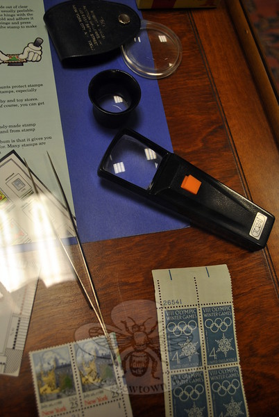 Magnifying glasses and other tools used by stamp collectors are part of the Brookfield Philatelic Society exhibit on view at C.H. Booth Library. (Crevier photo)