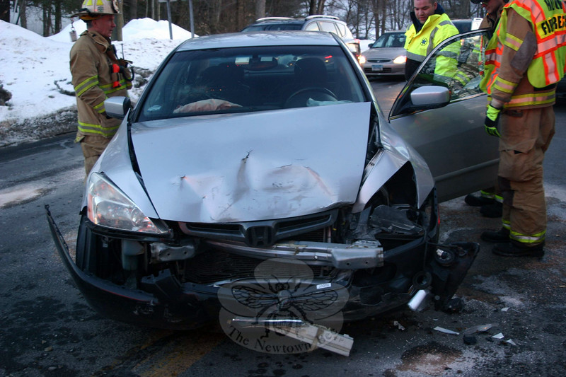 Town police, Sandy Hook volunteer firefighters and Newtown Volunteer Ambulance Corps responded to a two-car accident on Wasserman Way, near the entrance to the Exit 11 commuter parking lot, at about 5:16 pm on March 6. Police report that the collision involved motorist Joseph Vazquez, 53, of 1 Stone Fence Lane, who was driving a 2003 Honda Accord sedan, seen here, and motorist Michael Raczka, 52, of Southington, who was driving a 2014 Ford Fusion sedan. Vazquez was evaluated at the scene by ambulance staffers, but was not transported, police said. Police said they issued Vazquez a written warning for unsafe passing. (Hicks photo)