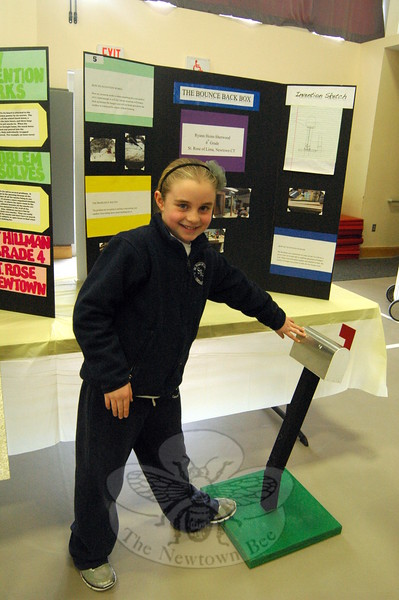 """St Rose of Lima School fourth grade student Ryann Heim-Sherwood demonstrated her Invention Convention entry """"The Bounce Back Box"""" on Thursday, February 26. Ryann's project was one of four that will go on to the state level of the competition.  (Hallabeck photo)"""