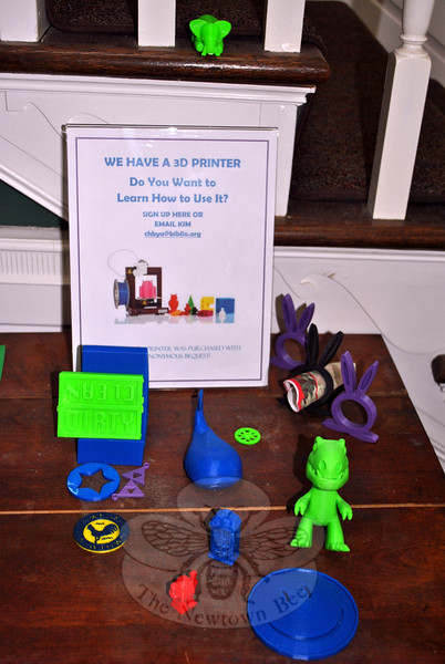 """A display at C.H. Booth Library shows examples of simple items that can be made on the 3D printer currently owned by the library. Money raised at the upcoming """"Modeling for Makers"""" gala will allow the library to expand on technology that encourages education and creativity. (Crevier photo)"""