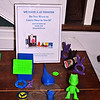 "A display at C.H. Booth Library shows examples of simple items that can be made on the 3D printer currently owned by the library. Money raised at the upcoming ""Modeling for Makers"" gala will allow the library to expand on technology that encourages education and creativity. (Crevier photo)"