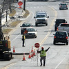 Flaggers were positioned on Church Hill Road, near its intersection with Wendover Road, on Wednesday, March 11, to direct traffic flow as workers for the Aquarion Water Company made some new temporary road patches at the site where a water main sprung leaks during extremely cold weather in late February. Permanent patches are planned for the site after area asphalt plants open this spring. (Gorosko photo)