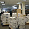 Workers were still working furiously as of Thursday, March 12, to replace nearly 35,000 books to their proper places in the Children's Department of the C.H. Booth Library. The Children's Department has been closed to the public since pipes burst overhead, Tuesday, February 17, flooding the area and destroying more than 10,000 books. Library Director Brenda McKinley said that she is hopeful the Children's Department will reopen over the weekend. Patrons should continue to check the library's website, chboothlibrary.org, for updates on programming and reopening. (Crevier photo)