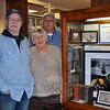 From left is Bill Hamilton, president of the Brookfield Philatelic Society; and society members Maxine Mangiafico and Robert Lund, standing near one of three stamp displays at C.H. Booth Library, promot-ing the hobby of stamp collecting. (Crevier photo)