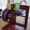 "A 3D printer in the Young Adult Department of the library attracts users of all ages. Money raised at the April ""Modeling for Makers"" event will allow the library to purchase additional 3D printers, to accommodate requests. (Crevier photo)"