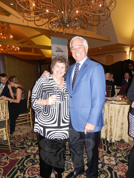 Marsha Moskowitz worked the floor with auctioneer Bobby Valentine during the live auction portion of the evening. Their enthusiasm helped raise paddles in the air and put dollars in the NSA bank for future scholarship recipients. (Sherri Smith Baggett photo)
