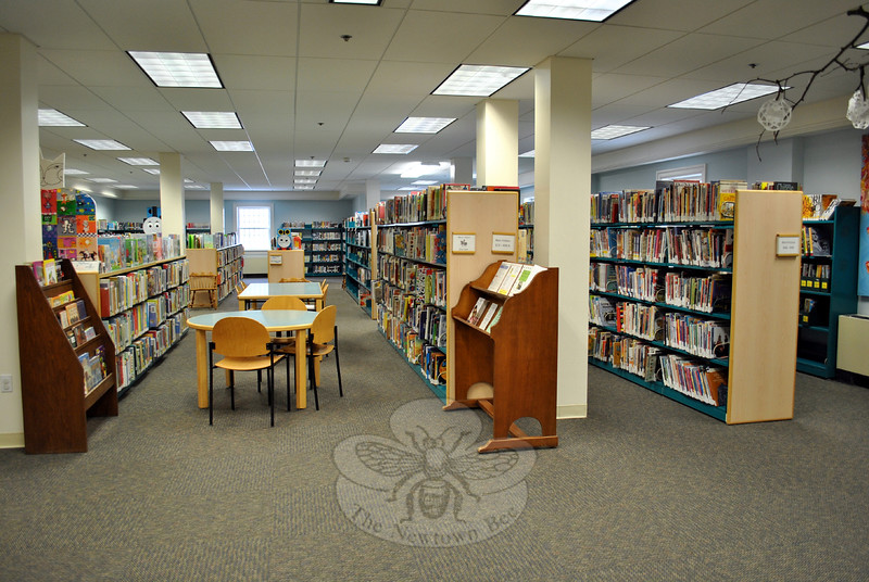 New ceiling and carpet tiles give the Children's Department of C.H. Booth Library a fresh look. Shelves full of books are ready for checking out, although the loss of 10,000 water-damaged books means some favorites may not yet be available. (Crevier photo)