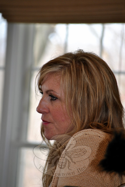A pensive Carolyn Tuft listens to a response to her story of the 2007 shooting at a Utah mall that killed her daughter and four other people. (Crevier photo)