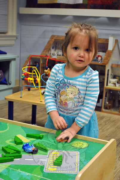 Two-year-old Payton Walters stopped by the Children's Department with her mother, Mariel Walters, to play on the first day that department was reopened. (Crevier photo)