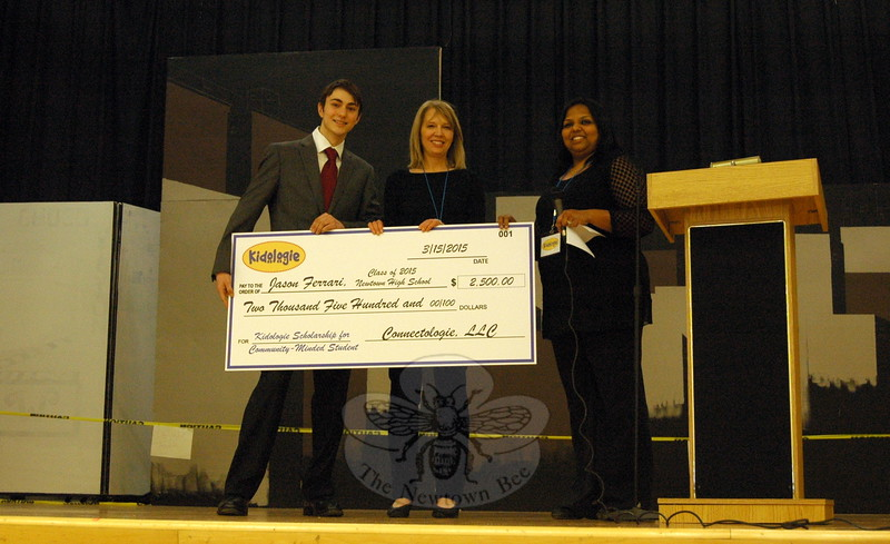 Newtown High School senior Jason Ferrari, left, accepted a $2,500 scholarship on Sunday, March 15, from Connectologie partners Lisa Agresta, center, and Geetha Selva, during the 3rd Annual Kidologie Gets Ready for Summer event held at Reed Intermediate School. (Hallabeck photo)