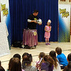 "As a celebration to kick off Sandy Hook School's One School, One Read event on Friday, March 13, Danny Rodrigue, stage name Danny Magic, performed for the entire school. During one performance, he presented kindergartener Reinna Bianco, right, with a rabbit after ""mixing"" together a birthday cake. (Hallabeck photo)"