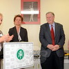 First Selectman Pat Llodra, left, delivers opening remarks before a ribbon-cutting celebrating the opening of the Newtown Middle School Health Center March 13. Prior to the official ribbon cutting, Mrs Llodra was joined by about two dozen school district officials and center supporters including Melanie Bonjour, the school-based health center manager for the Connecticut Institute for Communities, her colleague, former congressman and institute CEO James Maloney, and Newtown Health District Director Donna Culbert. (Voket photo)