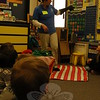 Milton, a barn owl, spread his wings for students in Head O' Meadow first grade teacher Carol Howard's class on Monday, March 9, after Connecticut Audubon Society Education Manager and teacher Tricia Kevalis, standing, asked him to show his wings to the students. (Hallabeck photo)