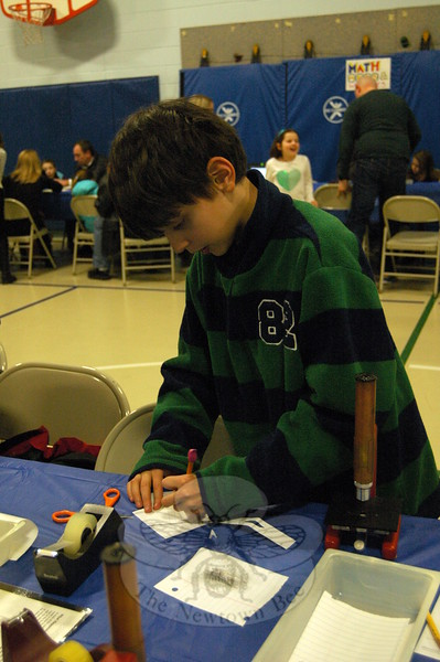 "Hawley Elementary School student Alex Rodriguez worked to inspect his own fingerprint at the ""Magnify This"" station, offered through EverWonder Children's Museum, at Hawley's STEM Night, held on Wednesday, March 4. (Hallabeck photo)"