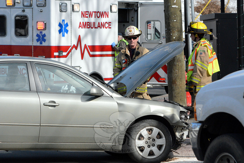 Town police, the Newtown Volunteer Ambulance Corps, and the Sandy Hook Volunteer Fire & Rescue Company responded to a one-car accident about 3 pm on March 13 in Sandy Hook Center. The incident caused travel delays in the area. Police said motorist Thomas Sheehan, 58, of Bethel was driving a 2008 Hyundai Sonata sedan southward on Glen Road and then drove through the intersection of Glen Road, Church Hill Road, Washington Avenue, and Riverside Road. The auto then mounted the sidewalk and struck the railings on the Church Hill Road bridge above the Pootatuck River. Police said a medical situation resulted in the crash. Police took no enforcement. Police said Sheehan was transported to Danbury Hospital. (Gorosko photo)