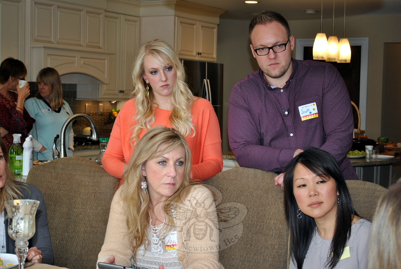 Standing, from left, Kait Hinckley Wood and Scott Hinckley, and seated, Carolyn Tuft, all of Salt Lake City, Utah, and NAA President Po Murray listen to a guest speak at a private luncheon held Monday, March 16. Ms Tuft, a survivor of a 2007 shooting in which her 15-year-old daughter was killed, and Ms Wood and Mr Hinckley, two of her three surviving children, are guests of Newtown residents Nicole and Richard Friedrich. (Crevier photo)