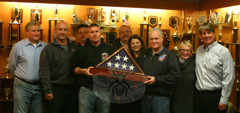 Bill Halstead, third from right, was honored on March 23 by the Board of Fire Commissioners for his 50th anniversary as a volunteer firefighter. With Mr Halstead, from left, are Commissioners Ron Bolmer, Tim Whelan, and David Jossick, Chairman Rob Manna, Commissioner Jay Nezvesky, Mr Halstead's wife Debbie Aurelia Halstead, and Commissioners Lisa Goosman and Kevin Cragin.	(Hicks photo)