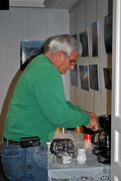 A custodian's work is never done — even at his own retirement party. C.H. Booth Library custodian Ralph Scogno makes a fresh pot of coffee for staff members. (Crevier photo)