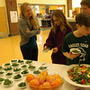 "Reed Intermediate School fifth graders Hunter Bailloargon, front right, and Anna Steinel, center, were two of the first students to take a sample of a ""Color Burst Salad"" offered by Chartwells School Dining Services at Reed Intermediate School on Thursday, March 12, in celebration of National Nutrition Month. Chartwells School Dining Services Resident Dietitian Jill Patterson, left, looked on as students took samples. (Hallabeck photo)"