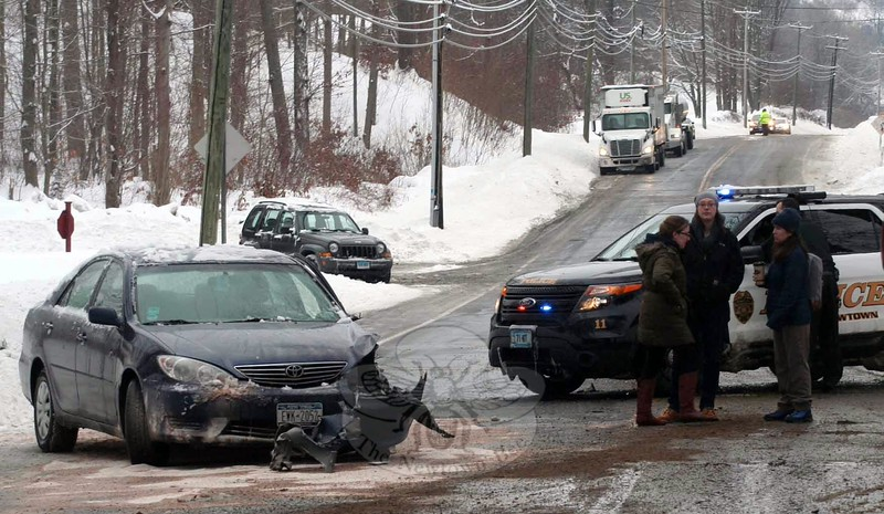 The driver of a Toyota sedan, above left, was uninjured Monday morning after her vehicle hit the rear-end of a gasoline tanker while both vehicles were traveling north on South Main Street. The Lee Transport tanker in the right photo had damage to its tank, which led to an unknown amount of gas being spilled before it was fully contained. (Hicks photo)