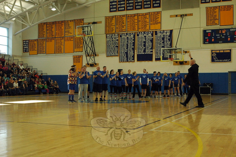 "Head O' Meadow physical education teacher Steve ""Coach"" Dreger coached the Newtown team, which was made up of district teachers, staff, and administrators. The team was introduced before the took on the Harlem Wizards during the Sunday comedy basketball fundraiser. (Hallabeck photo)"
