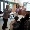 First Selectman Pat Llodra, left, and Community Center Advisory Committee co-leader Andrew Clure address a common room filled to capacity with seniors interested to hear about plans for the construction of a new community center at Fairfield Hills. The project's first phase would be a senior center. (Bobowick photo)