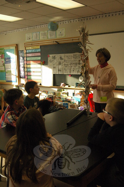"Pam Fagan, an Education Council member with EverWonder Children's Museum, led Middle Gate Elementary School students on Tuesday, February 24, through creating ""newspaper trees"" during an after school session of the ""EverWonder on the Road"" program. (Hallabeck photo)"