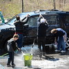 A group of volunteers pitched in and thoroughly washed a SUV at a fundraising car wash for Newtown Savings Bank's Relay For Life team on Saturday, April 25, in a parking lot behind the bank's main branch at 39 Main Street. The car washing crew was well organized, setting up a production line to wash the dozens of vehicles which were cleaned. (Gorosko photo)