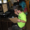 Brother and sister AJ and Grace Zatulskis worked in Middle Gate Elementary School's library/media center to complete a scavenger hunt on Tuesday, March 31, as part of the school's Special Night, which highlighted lessons offered in the school's special areas. (Hallabeck photo)