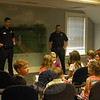 """The Moms Club of Newtown hosted a """"Meet A Police Officer"""" event on Saturday, April 18, at C.H. Booth Library for children to meet a police officer, play games, and create crafts. Bethel Police Officer James Christos, standing left, and Brookfield Police Officer Sean Flynn, standing right, shared aspects of what they do as police officers during the event.     (Hallabeck photo)"""