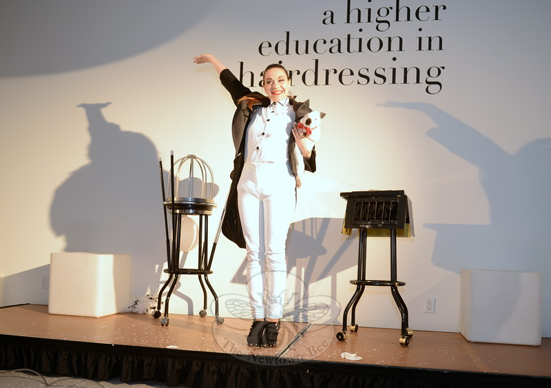 TONI&GUY Hairdressing Academy in Newtown held a grand opening Saturday, April 25. The night's celebration included a brief performance by illusionist Melissa Russo. (Bobowick photo)