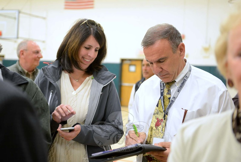 As poll moderators read off the night's count, Board of Education member Laura Roche and Superintendent Joseph V. Erardi, Jr, add up the numbers and realize that the budgets for the town and school board have passed. (Bobowick photo)