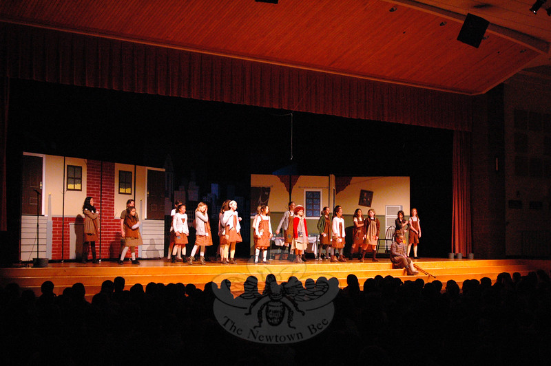 """Cast members of Reed Intermediate School's Annie Jr production performed """"It's The Hard-Knock Life"""" during a school assembly on Friday, May 8. (Hallabeck photo)"""