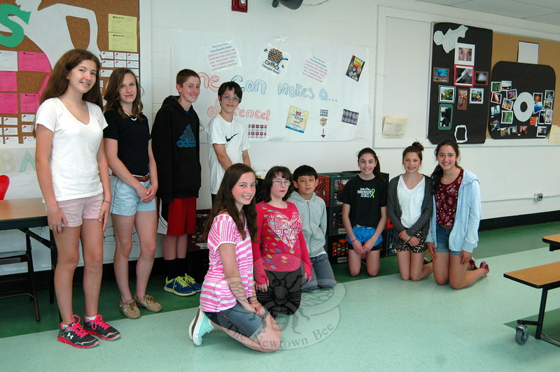 A joint effort by the Newtown Middle School's Interact Club and its Student Council collected food items from March 23 to April 30 at the school to donate to the FAITH Food Pantry, located at St John's Church in Sandy Hook. The Interact Club also visited the FAITH Food Pantry on May 6 to donate the collection, tour the facility with food pantry Co-Chair Barbara Krell, and help sort the donated items. Some Interact Club and Student Council members also gathered together for a photo on May 5, with the collected items in bins. From left are Emma DaSilva, Carly Sweirbut, Bobby Elston, Bryce Bisset, Madeline Larson, Jessica Andrertta, Kevin Gong, Jackie Tibolla, Ellie Moxham, and Katarina Rosen. (Hallabeck photo)